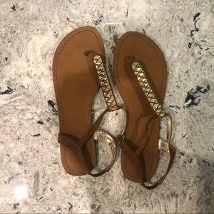Tan sandals with gold detail